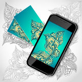 Mobile telephone with flowers screen visit cards in blue green Stock Photography