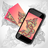 Mobile telephone with flowers screen visit cards in pink yellow Stock Photo