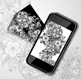 Mobile telephone with visit card black white doodle flowers Stock Photo
