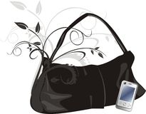 Mobile telephone and womanish bag Stock Image