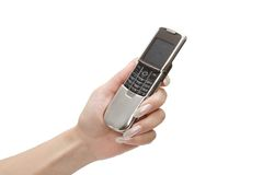 Mobile telephone in women hand stock images