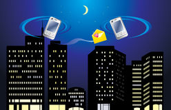 Mobile telephones on the background of night city Royalty Free Stock Image