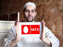 Mobile TeleSystems , MTS, logo. Logo of Mobile TeleSystems , MTS, on samsung tablet holded by arab muslim man. MTS is the largest mobile operator in Russia and stock image