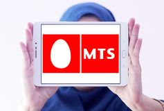 Mobile TeleSystems , MTS, logo. Logo of Mobile TeleSystems , MTS, on samsung tablet holded by arab muslim woman. MTS is the largest mobile operator in Russia and royalty free stock photo