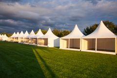 Mobile tent for trade show. At amazing sunset stock photography