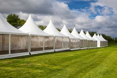 Mobile tent for trade show. At amazing sunset stock photo