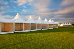 Mobile tent for trade show. At amazing sunset stock images