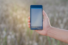 Mobile touch screen phone natural background Royalty Free Stock Photo