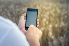 Mobile touch screen phone natural background Royalty Free Stock Photos