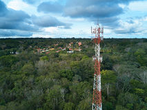 Mobile tower antenna. Aerial view on small town background stock images