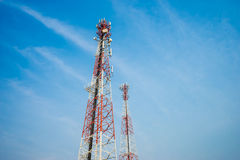 Mobile tower antennas with blue sky background. Stock Photos
