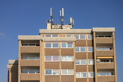 Mobile tower. Some cell tower of the roof top of an apartment building Royalty Free Stock Photography