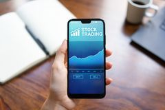 Mobile trading application with stock market chart on smartphone screen. Forex investment business technology concept. Mobile trading application with stock royalty free stock photos