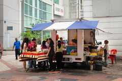 Mobile vendor sell fast food on a street Royalty Free Stock Photo
