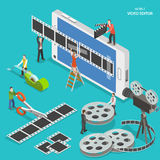 Mobile video editor flat isometric vector concept. People create a movie on smartphone using film strip and sticky tape Stock Photos
