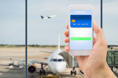 Mobile wallet in airport Stock Photo