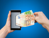 Mobile wallet. Withdrawing money from a mobile Stock Image