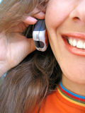 Mobile woman. A smiling Woman talks by a mobile phone Royalty Free Stock Image