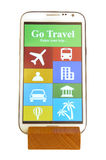 Mobile on wooden holder. With travel app interface Stock Images