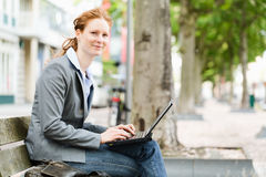 Mobile Workplace - Businesswoman in a City Stock Images