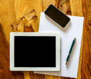 Mobile workplace with a tablet pc and phone Stock Photo