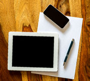 Mobile workplace with a tablet pc and phone Stock Photos