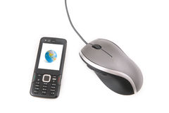 Mobilephone and Mouse. Isolated ergonomic mouse and a black mobile phone with globe on the screen shot over white background Stock Photography