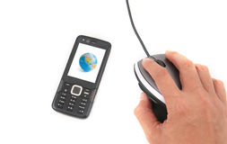 Mobilephone and Mouse. A man is using a mouse and a black mobile phone with globe picture on the screen shot over white background Royalty Free Stock Image