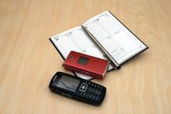 mobiles e penna del calendario Fotografie Stock