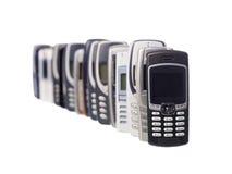 Mobiles in een rij stock foto