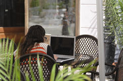 Mobility. Women using a laptop on a terrace Stock Photos