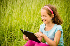 Mobility - child with tablet outdoor Royalty Free Stock Image