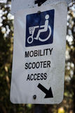 Mobility scooter access sign. Age for people with disabilities Stock Photos