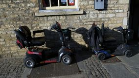 Mobility scooters parked on the street ,transportation for disabled people. Mobility scooters parked on the street ,transportation for disabled people stock footage