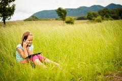 Mobility -  watching tablet and calling phone Royalty Free Stock Photos