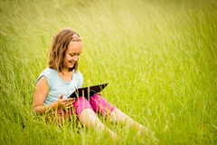 Mobility -  watching tablet outdoor Stock Photography