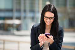 Mobility - woman with smartphone Stock Image