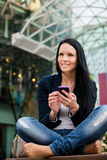 Mobility - woman with smartphone Stock Photography