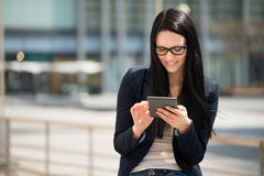 Mobility - woman with tablet Stock Images