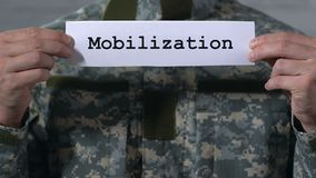 Mobilization written on paper in hands of male soldier, military service. Stock footage stock video
