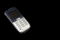Mobille phone. Mobile Phone in a black background royalty free stock photos