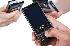 mobilni ludzie dzwonią trzy używać Obrazy Stock