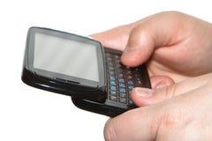 mobilt smsskrivande för mobiltelefon Arkivfoto