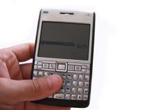 Mobiltelefon in der Hand Lizenzfreies Stockfoto