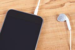 mobiltelefon för hörlurar 3d Arkivfoto