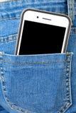 Mobiltelefon i bakficka av flickas jeans royaltyfria bilder