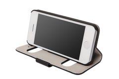 Mobiltelefon i påsen Arkivbild