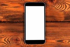 Mobiltelefon med åtlöje för tom skärm upp på gul wood tabellbakgrund Smartphone på den Wood tabellen Smartphone vit skärm royaltyfria foton