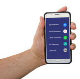 Mobiltelefon med alternativ för försäkring Arkivfoton