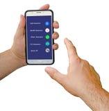 Mobiltelefon med alternativ för försäkring Arkivbilder